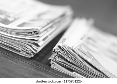 Two piles of newspapers. Daily papers with news folded and stacked, top view