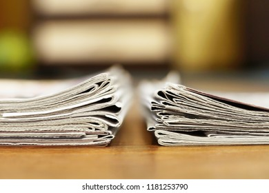Two piles of newspapers. Daily papers with news folded and stacked, side view