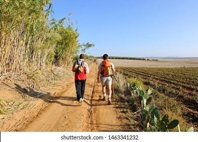 Two pilgrims between Guillena and Castilblanco in Way to Santiago (Via de la Plata) at province of Seville  Andalusia. Via de la Plata is St. James Way (Camino de Santiago) from Seville to Santiago