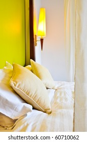 Two pillows on the bed with Lamp