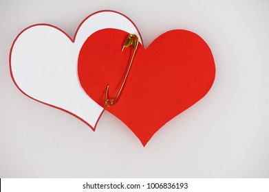 two pined paper  white and red hearts on white background
