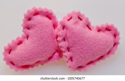 Two pink hearts on a white background