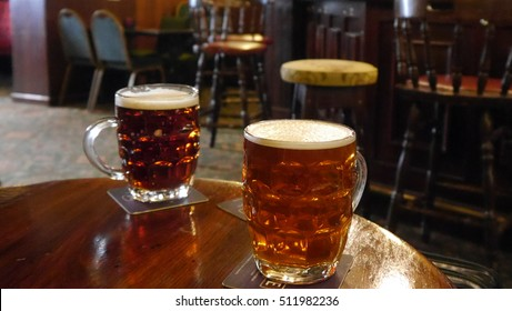 Two pints of beer on the table of an pub in England
