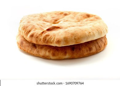 Two pita bread isolated on white background. Plain bread.