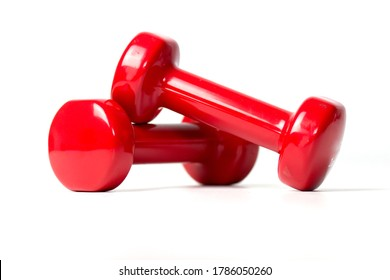Two plastic coated dumbells isolated on white. Top view.