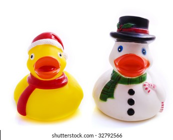 Two plastic ducks in christmas outfit on a white background