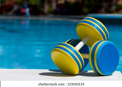 Two plastic dumbbells for water aerobics