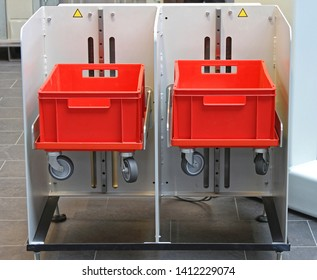 Two Plastic Red Crates With Tray Wheels