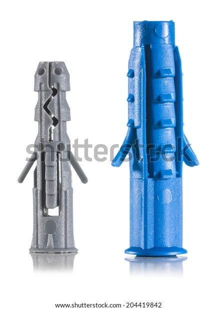 two plastic wall anchors isolated macro