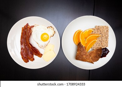 Two plates full of traditional breakfast foods on a table.