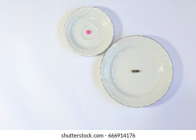 Two plates with pills