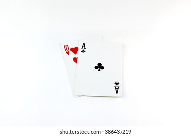 two playing cards ace and a ten