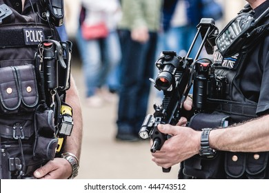 Two Police Officer with Machine-Gun in London close up horizontal photography