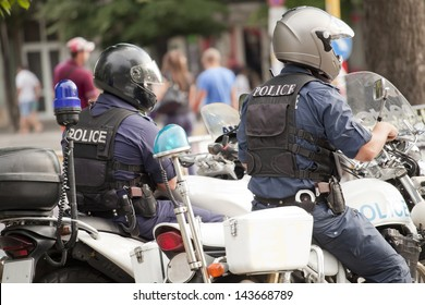 Two police officers on police bikes