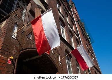 Two polish flags on builing