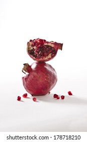 Two Pomegranates on white background, close-up. Shot with copy space