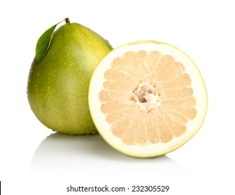 Two pomelos,half with drops water and leaf isolated on white background