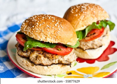 Two pork burgers on a plate