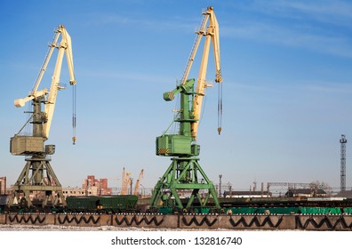 Two port cranes with cargo train. Port of St.Petersburg, Russia