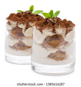 two portions Classic tiramisu dessert in a glass isolated on a white background with clipping path