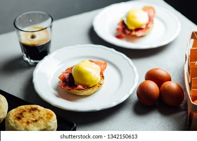 Two portions of the egg benedict served on a grey table