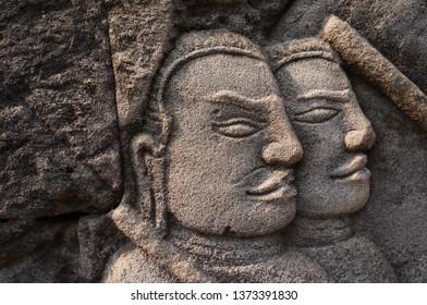 Two portrait bas-reliefs at  Bayon temple about khamer history, Siem Reap, Combodia.
