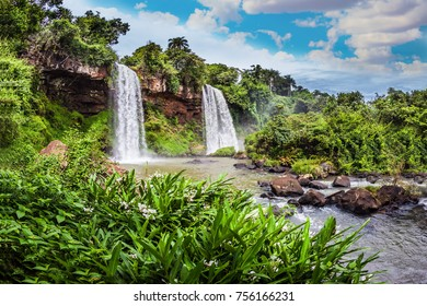 Two powerful fairy waterfalls from Iguazu Falls in Argentina. The concept of extreme and ecological tourism. Picturesque ledges form the famous waterfalls