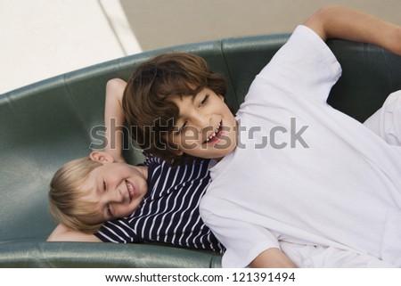 Two boyz enjoying themselves on the sofa