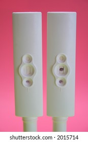 Two pregnancy test kits showing both negative and positive results