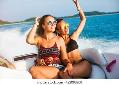 Crazy bikini women on boats