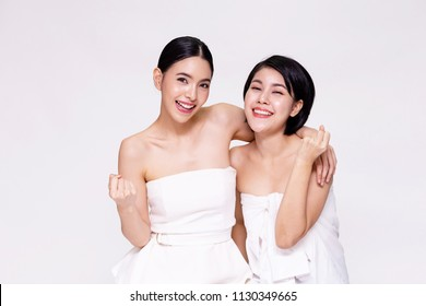 Two pretty and cute cheerful Asian woman with positivity cheering up in white isolated background