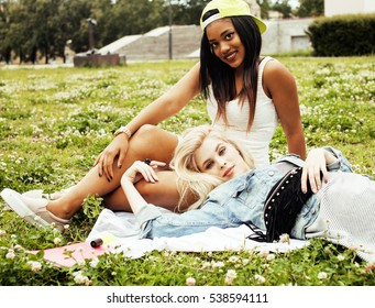 two pretty girls on grass happy smiling, best friends having fun together, lifestyle people concept