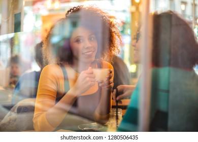 Two pretty girls sitting in a bar