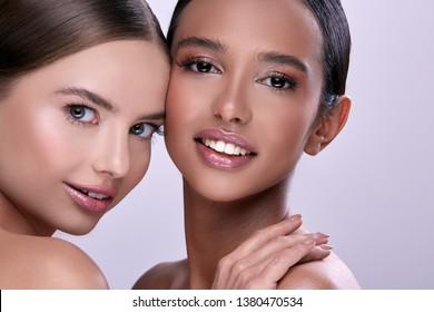 two pretty girls smiling