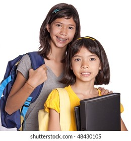 Two pretty sisters wit folders, files and bags ready for school