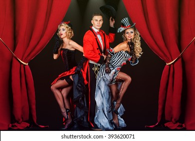 two pretty young blonde girls with men in formal retro clothes dancing Broadway style