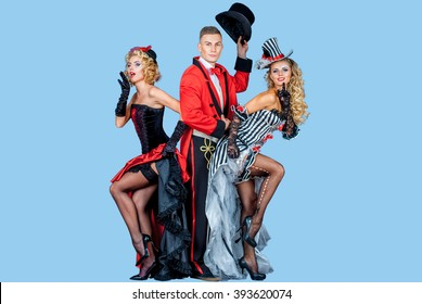 two pretty young blonde girls with men in formal retro clothes dancing Broadway style, isolated