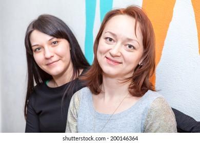 Two pretty young women portrait