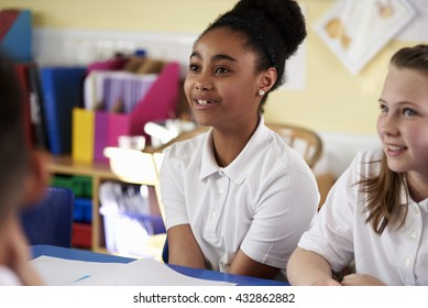 Two primary school girls in class, close up