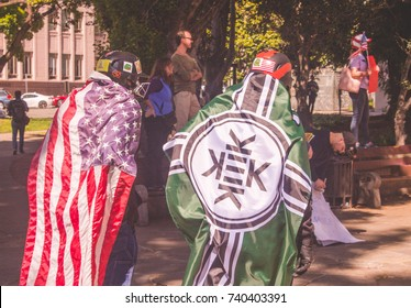 Two pro Trump men wrapped in flags at Pro & Anti Trump Rally. Berkeley, Ca. April 16th, 2017