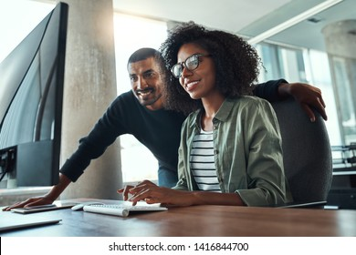 Two professional business people working together in office