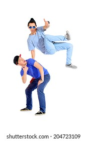 Two professional dancers dancing hip-hop at studio. Isolated over white.