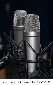 Two professional studio microphones on stands, podcasting, voiceover