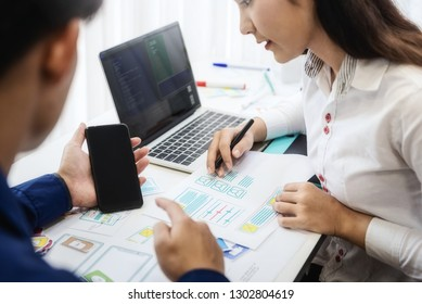 Two programmer test coding technologies with mobile phone for comparing mobile and desktop website. User experience concept.