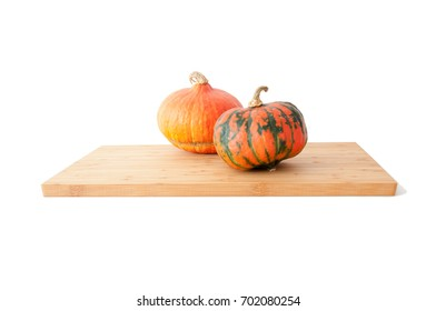Two pumpkins on a bamboo board