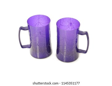 Two purple Halloween tankards with spider and web pattern, standing side by side. Taken in the studio against a white background.