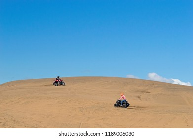 two quadricycles at the dunes