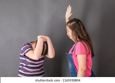 Two quarreling sisters. The eldest brought her hand to strike