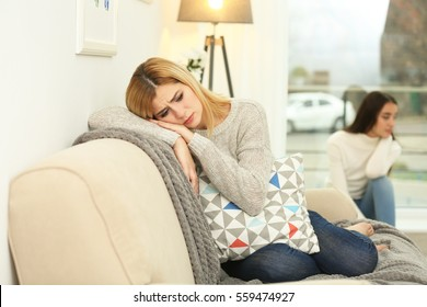 Two quarrelled women in bad mood at home