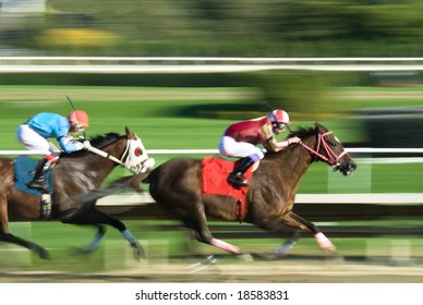 Two racing horses competing with each other, with motion blur to accent speed
